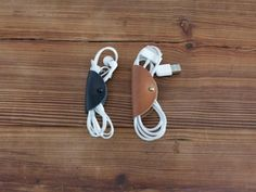 Handcrafted leather tethers for keeping USB cords & earbuds in place.