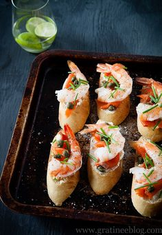 Prawn and Smoked Salmon Crostini with Boursin Cheese, Capers, and Chives