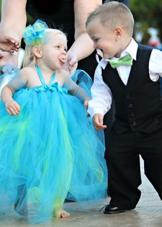 cutest flower girl ever, buttt they must be holding hands and they must be in blue and white.