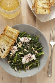 Spinach with sumac, pine nuts, and fresh cheese