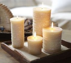 'Cause all good lanterns need a sea scented candle!  Scented Rope Pillar Candles #potterybarn
