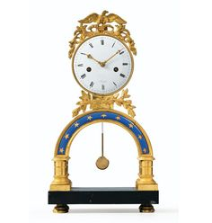 A GILT-BRONZE ENAMELED MANTEL CLOCK, EARLY 19TH CENTURY ; the movement signed Ribot - Dim: H:. 40,5 cm, W:. 22 cm // Height 16 in; width 8 2/3 in.