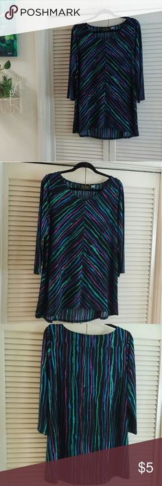 Bob Mackie Wearable Art Tunic Top, Size Large Bob Mackie Wearable Art tunic top, size large.  Features v neck and slight high/low hemline.  Black, blue, green, purple, and hot pink striped print.  Very soft and flattering.  Goes well with leggings or pants.  Excellent condition! Bob Mackie Tops Tunics