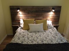 Pallet headboard with shelf, lights and plugs for cell phones. Created for customer