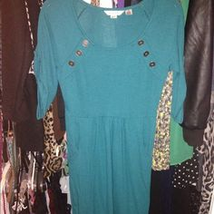 Turquoise/Greenish dress. Very cute on. Worn once has pockets and buttons on shoulders and sleeves. Dresses