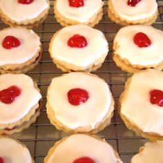 Empire Biscuits- This shortbread cookie is a traditional Scottish recipe. These are round cookies sandwiched with jam and topped off with a delicious icing and a cherry-Instantly reminds me of BRAVE Scottish Recipes, Irish Recipes, Scottish Desserts, Scottish Dishes, English Recipes, Tea Recipes, Paleo Recipes, Cookie Exchange, Empire Biscuit Recipe