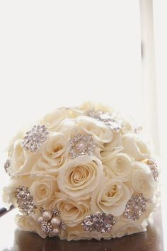 white roses and bling via Dawn Joseph Photography / http://www.himisspuff.com/spring-summer-wedding-bouquets/7/