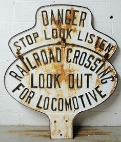 "Massive cast iron railroad sign ""DANGER/STOP LOOK LISTEN/RAILROAD CROSSING/LOOK OUT/FOR LOCOMOTIVE""."