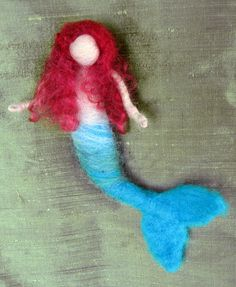 This needle felted Mermaid is a cute Waldorf inspired doll. She is made of 100% wool. Her body has wire inside, so her arms and tail can be positioned