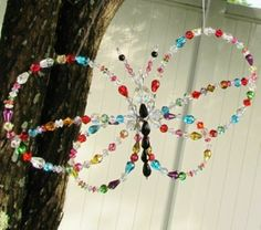 Crystals & Glass Beads + Butterfly + Garden = sparkly goodness for a DIY Sun Catcher via www.hometalk.com