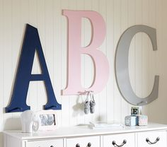 Make my own with unfinished wood and hooks...L and C in bathroom.  Jumbo Letter Hooks | Pottery Barn Kids