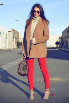 This combination of a brown coat and red skinny jeans is a great outfit formula to have in your arsenal. A cool pair of tan suede pumps is an easy way to upgrade your look.  Shop this look for $299:  http://lookastic.com/women/looks/sunglasses-turtleneck-coat-tote-bag-skinny-jeans-pumps/4252  — Dark Brown Sunglasses  — Beige Wool Turtleneck  — Brown Coat  — Dark Brown Print Leather Tote Bag  — Red Skinny Jeans  — Tan Suede Pumps