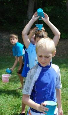 would be fun to do as a relay. The first kid starts with a full cup of water, then pours it over his head and the second kid catches it and repeats and they keep doing this to see who can fill up a jar the fastest