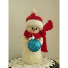 Needle Felted Holiday Snowman All Decked Out In Red Wool Scarf And Hat. $17.00, via Etsy.