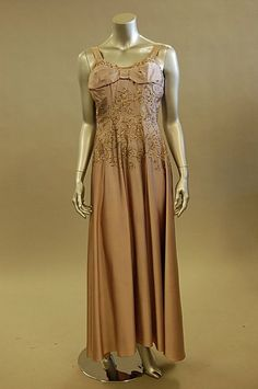 A Jeanne Lanvin lilac satin ball gown, mid 1950s but later altered, bearing large woven label, date stamp indistinct, embroidered to the bodice and hips with scrolling foliage in silver thread and sequins. Front