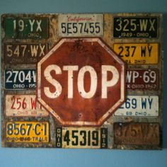 Old house siding, with an antique stop sign & old license plate, as a wall hanging.