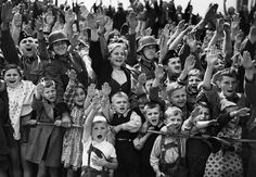 A crowd of women, children and soldiers of the German Wehrmacht give the Nazi salute on June 19, 1940, at an unknown location in Germany. (AP)