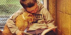 children reading to shelter cats