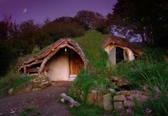 Photographer Simon Dale spent $5,000 and 4 months to turn a plot of land in the woods into a hobbit home. It boasts a number of eco-friendly attributes, which include: scrap wood for flooring, lime plaster (instead of cement) for the walls, bales of straw on dry-stone walling, a compost toilet, solar panels for power, and a supply of water acquired through a nearby spring.