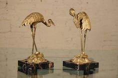 (Warehouse 414) Incredible pair of cast brass wading birds in wonderful condition. Each bird is standing on a lily pad which is attached to a square black and gold piece of vintage marble.  Vintage for sure but exact age unknown. - #sculpture #brass #heron #cranes #marble