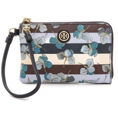 NWOT Tory Burch Kerrington Wristlet NWOT Authentic Tory Burch Kerrington Convertible Wristlet. A vintage-inspired floral print and muted stripes lend sweet detail to this pebbled faux-leather Tory Burch wristlet. The wraparound zip opens to a lined interior with 1 zip pocket and 3 card slots. Fabric: Faux leather. Measurements Height: 4in  Length: 6in.  ❤️Brand new without tags!!! Recieved as a Christmas gift. Includes Tory Burch gift bag and tissue. No trades/pay pal. Tory Burch Bags…