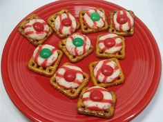 Pretzles, Candy Cane Kisses + an M&M in an oven for 5-6 min at 200 degrees. Simple.