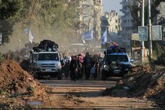 @UN vehicles lead the evacuation from the Old City of #Homs. © SARC/B.AlHafez