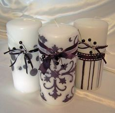 DIY Christmas Gift! Use Elmer's glue or tacky glue to create a simple design (possibly snowflakes) on a dollar store pillar candle and then add glitter! Or you can do a monogram glitter candle! So fun!