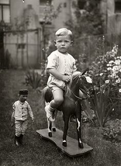 Little boy on his toy horse