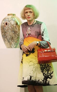 British artist Grayson Perry is known mainly for ceramic vases and cross-dressing. Perry's work refers to several ceramic traditions. Grayson Perry, Interior Art Nouveau, Miraculous, Vase Design, Blue Pottery, Raku Pottery, Charlotte, English Artists, Portraits