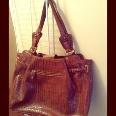 """Jessica Simpson Croc Embossed Sasha Tote Jessica Simpson Croc-Embossed Sasha Tote  RETAILS FOR $108.00...NO LONGER IN PRODUCTION...FABULOUS FIND!  •Color: Brown  Handles attached to top of bag with antique brass-tone oval rings & """"JS""""-ingrained  •Fully lined in a stunning black/white/gray/aqua checkered & floral print polyester fabric  •Approximate measurements are 14 inches in length ,11 inches in height,5 inches in depth, & handle/strap drops of 8.5 inches Jessica Simpson Bags Totes"""