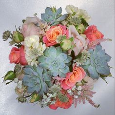 Wedding bouquet. Miss Piggy roses, stocks, sweet avalanche spray rose, astilbee and succulents