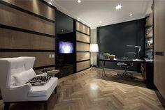 dark wall, wood chevron floors, handsome desk, makes a stunning room