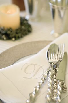 Monogrammed linen napkin and sterling silver