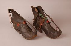 1860-1869 Embroidered boots Circassian-Turkey- Ottoman Empire, (pair of) made of leather (goat-skin), iron, buttons (brass), thread (silver, cotton?), thread (cotton?).  The front is embroidered with silver and green thread. British Museum