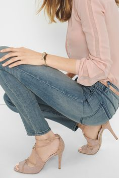 Blush blouse and shoes with faded blue jeans