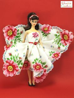 """TWO vintage hankies went into making this unique dress! The skirt is made from a single gorgeous hankie, its red flowers separated by French blue daisies, its Kelly-green leaves on a pristine white background. Strapless bodice features the second vintage hankie. Its embroidered flower is a perfect match for the skirt! It fits 11.5"""" Barbie, the custom designed Hankie Couture doll, and similar-sized dolls! By Hankie Couture, sold on eBay in April 2015#HankieCouture #doll #hanky #red #Barbie"""