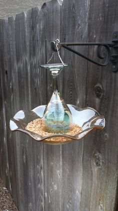 Hey, I found this really awesome Etsy listing at https://www.etsy.com/listing/180456472/amber-and-blue-glass-hanging-bird-feeder