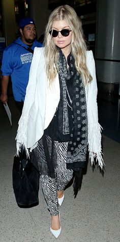 Trend Alert! Celebrities Wearing White Shoes: Fergie did airport style right by accessorizing a black-and-white look with a patterned Saint Laurent scarf and bright pumps from her own namesake line. #InStyle