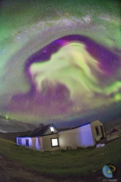 """Late August 2012 aurora in the shape of a goat's head, over Tasiusaq, Kujalleq, Greenland. Just to the left, near eye-level of the goat, in the clear portion of the sky is M31, the Andromeda Galaxy. The band of the Milky Way stretches across the top  of the image."" - looks more like FALKOR to me"