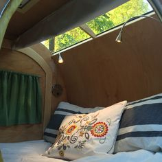 The interior and stargazer window of our homemade teardrop trailer