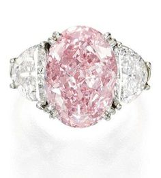Pink diamond and diamond ring, Oscar Heyman and Bros. Center stone: an oval-shaped Fancy Intense Pink diamond weighing approximately carats, flanked by carats of white diamonds. Via Diamonds in the Library. Pink Diamond Wedding Rings, Pink Diamond Jewelry, Pink Diamond Engagement Ring, Pink Jewelry, Diamond Rings, Pink Rings, Tiffany Jewelry, Engagement Rings, Diamond Pendant
