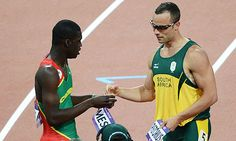 Kirani James (reigning World Champion) trades bibs with double-amputee Oscar Pistorius in the semi-final round of the Both purely amazing runners! Such an awesome sign of sportsmanship! Daegu, Oscar Pistorius, Andy Murray, Usain Bolt, Semi Final, Beach Volleyball, Summer Olympics, Roger Federer, Champs