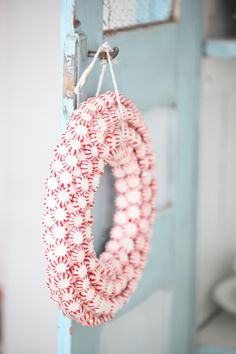 peppermint wreath on a big door.... or hanging from a blue mirror. I will be doing this at Christmas time!