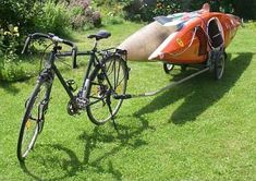 two kayaks being towed by bike using a Roland Carrie F trailer. I will be purchasing this very soon! Kayak Camping, Canoe And Kayak, Kayak Fishing, Outdoor Camping, Canoe Boat, Kayak Transport, Kayak Trailer, Bike Trailers, Kayak Equipment