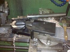 Radius Turning Tool by jackalope -- Homemade radius turning tool intended for mounting to a lathe's compound T-slot. Utilizes a machined hub and features tapered spindle bearings at the base. http://www.homemadetools.net/homemade-radius-turning-tool