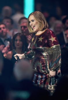 Photo by Ian Gavin/Getty Images. Big smile for Adele as she wins British Album Of The Year.
