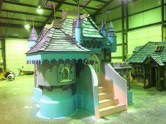 This is our Pretty Princess Castle wendy house in the workshop after we had finished painting it.