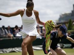 Madison Keys takes a towel from ball girl during her singles match against Olga Govortsova.  Pavel Golovkin, AP