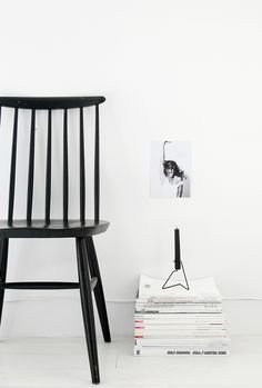 I love the way this Scandi style chair sticks out on this all white background. Black and white is so striking.